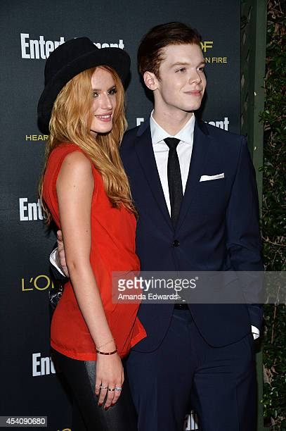 Actress Bella Thorne and actor Cameron Monaghan arrive at the 2014 Entertainment Weekly PreEmmy Party at Fig Olive Melrose Place on August 23 2014 in...