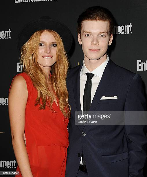 Actress Bella Thorne and actor Cameron Monaghan attend the 2014 Entertainment Weekly preEmmy party at Fig Olive Melrose Place on August 23 2014 in...