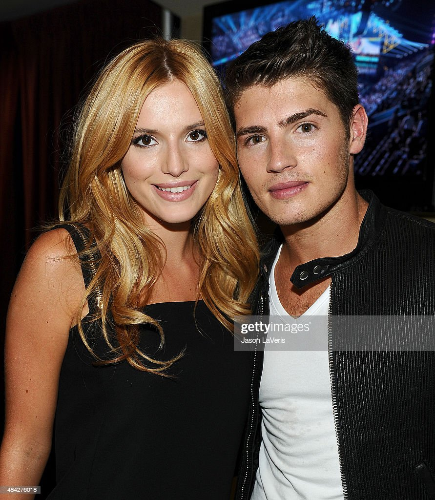 Actress Bella Thorne and actor Gregg Sulkin pose in the green room at the 2015 Teen Choice Awards at Galen Center on August 16, 2015 in Los Angeles, California.