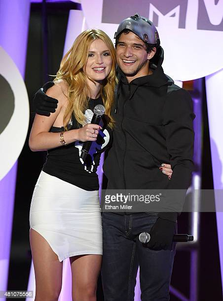 Actress Bella Thorne and actor Tyler Posey cohost the MTV Fandom Fest San Diego ComicCon at PETCO Park on July 9 2015 in San Diego California