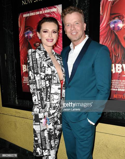 Actress Bella Thorne and director McG attend the premiere of The Babysitter at the Vista Theatre on October 11 2017 in Los Angeles California