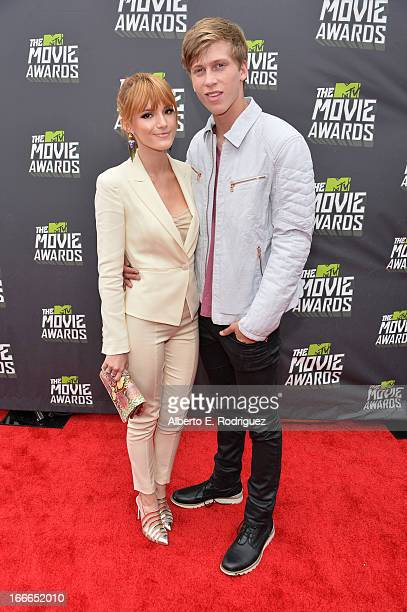 Actress Bella Thorne and guest arrive at the 2013 MTV Movie Awards at Sony Pictures Studios on April 14 2013 in Culver City California