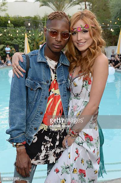 Actress Bella Thorne and guest attend the Official HM Loves Coachella Party at the Parker Palm Springs on April 10 2015 in Palm Springs California
