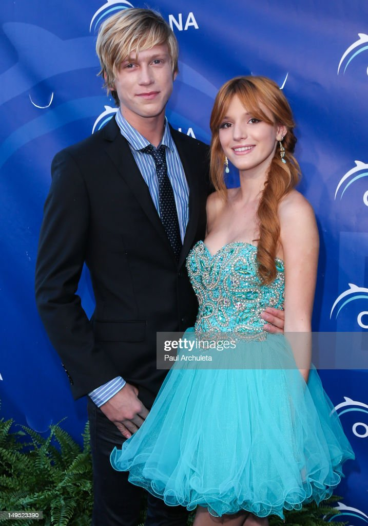 Actress Bella Thorne (R) and her boyfriend Tristan Klier (L) attend the 2012 Oceana's SeaChange summer party on July 29, 2012 in Laguna Beach, California.