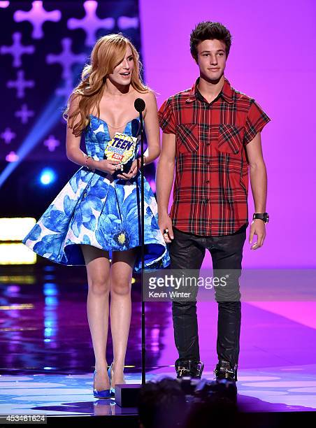 Actress Bella Thorne and internet personality Cameron Dallas onstage during FOX's 2014 Teen Choice Awards at The Shrine Auditorium on August 10 2014...