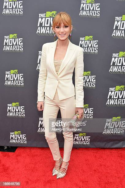 Actress Bella Thorne arrives at the 2013 MTV Movie Awards at Sony Pictures Studios on April 14 2013 in Culver City California