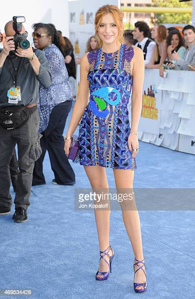 Actress Bella Thorne arrives at the 2015 MTV Movie Awards at Nokia Theatre LA Live on April 12 2015 in Los Angeles California