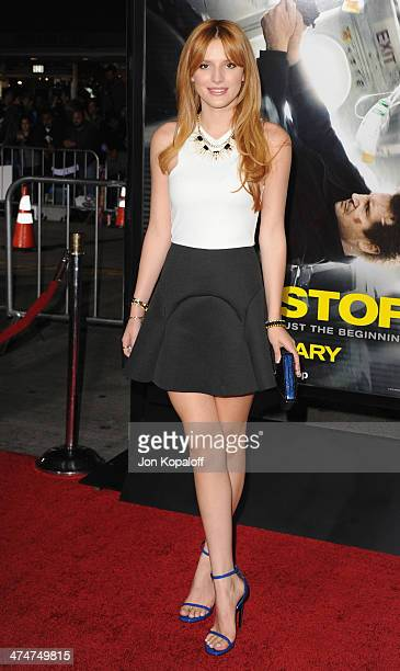 Actress Bella Thorne arrives at the Los Angeles Premiere 'NonStop' at Regency Village Theatre on February 24 2014 in Westwood California