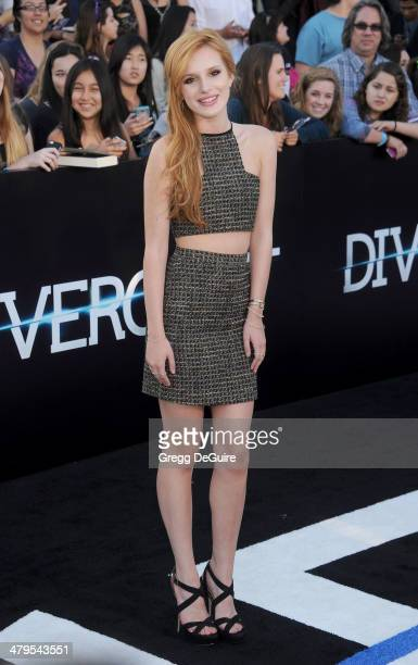 Actress Bella Thorne arrives at the Los Angeles premiere of Divergent at Regency Bruin Theatre on March 18 2014 in Los Angeles California