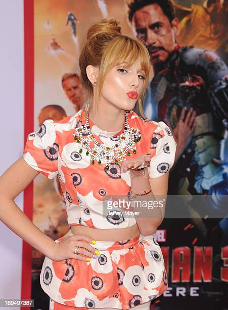 Actress Bella Thorne arrives at the Los Angeles Premiere of 'Iron Man 3' at the El Capitan Theatre on April 24 2013 in Hollywood California