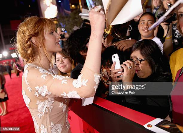 Actress Bella Thorne attends premiere of Lionsgate's The Hunger Games Catching Fire Red Carpet at Nokia Theatre LA Live on November 18 2013 in Los...
