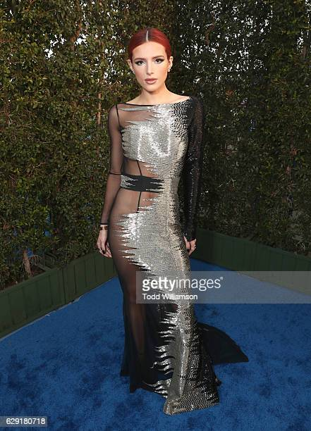 Actress Bella Thorne attends the 22nd annual Critics' Choice Awards with Porsche and the 2017 Panamera 4 EHybrid Executive at Barker Hangar on...
