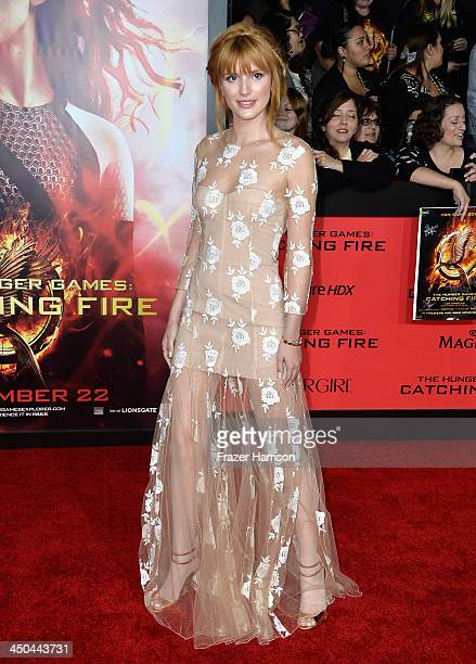 Actress Bella Thorne attends the premiere of Lionsgate's 'The Hunger Games Cathching Fire' at Nokia Theatre LA Live on November 18 2013 in Los...