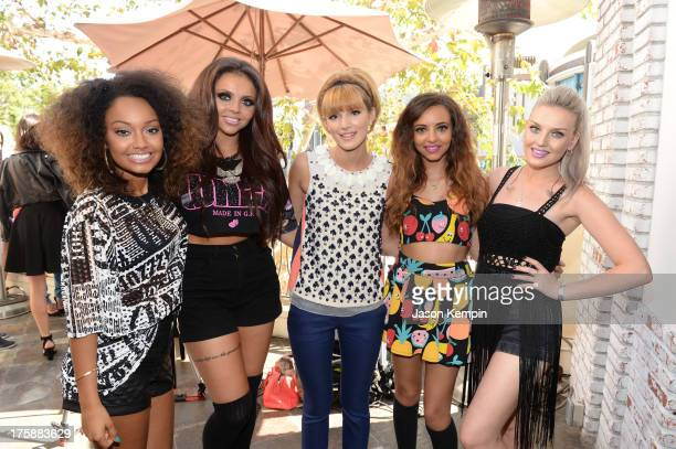 Actress Bella Thorne poses with LeighAnne Pinnock Jesy Nelson Jade Thirlwall and Perrie Edwards of Little Mix at Teen Vogue's BacktoSchool Saturday...