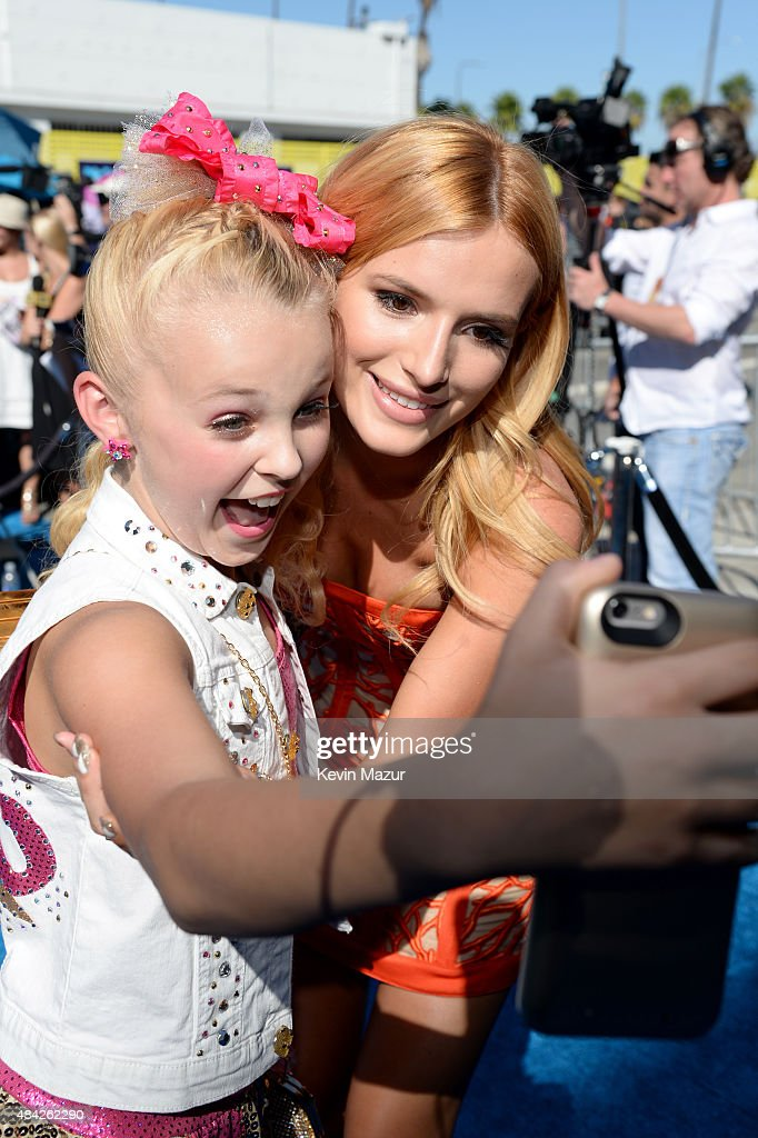Actress Bella Thorne takes a selfie with a fan during the Teen Choice Awards 2015 at the USC Galen Center on August 16, 2015 in Los Angeles, California.