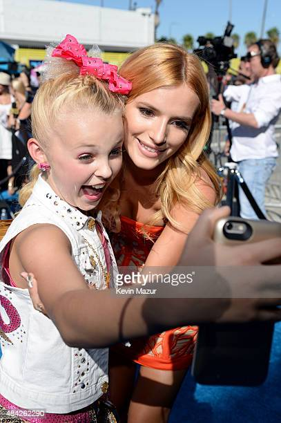 Actress Bella Thorne takes a selfie with a fan during the Teen Choice Awards 2015 at the USC Galen Center on August 16 2015 in Los Angeles California