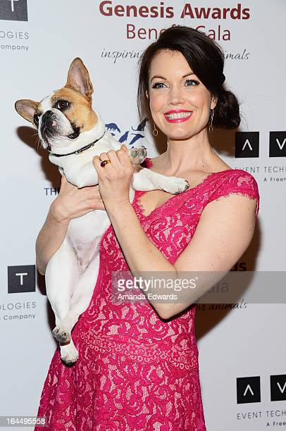 Actress Bellamy Young and Beatrice the dog arrive at The Humane Society's 2013 Genesis Awards Benefit Gala at The Beverly Hilton Hotel on March 23...