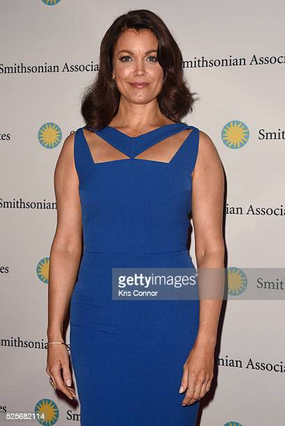 Actress Bellamy Young poses on the red carpet during the Scandalous event hosted by the Smithsonian Associates with Shonda Rhimes and the cast of...