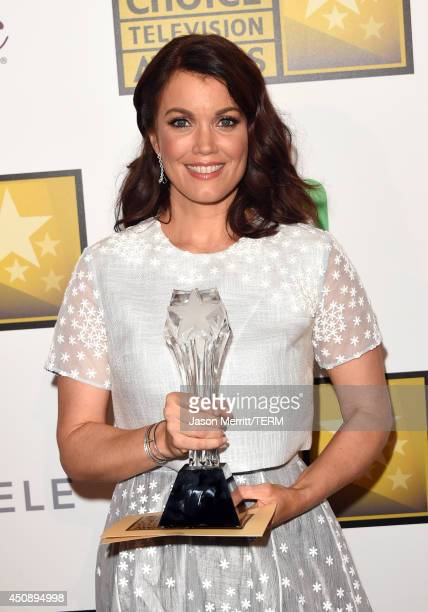 Actress Bellamy Young winner of Best Supporting Actress in a Drama Series poses in the press room during the 4th Annual Critics' Choice Television...