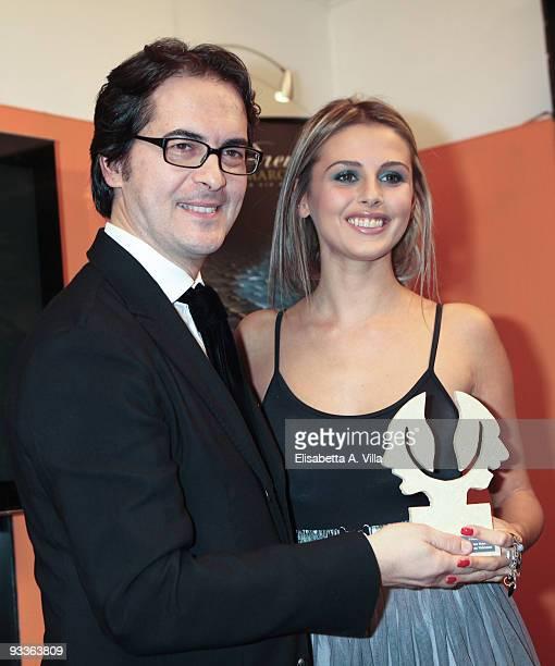Actress Benedetta Valanzano receives her award from Fashion Producer Antonio Falanga during the '2009 Margutta Awards' at Margutta RistorArte on...