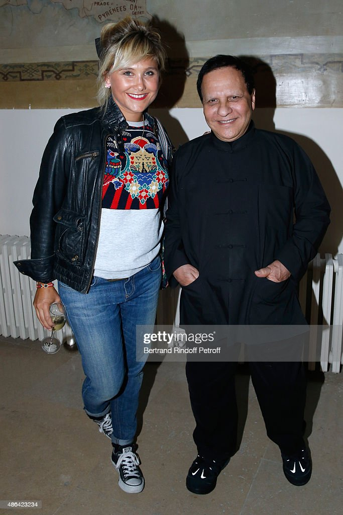 Actress Berengere Krief and Fashion Designer Azzedine Alaia attend the 'World Press Photo 2015' Exhibition Opening Party, held at Galerie Azzedine Alaïa on September 3, 2015 in Paris, France.