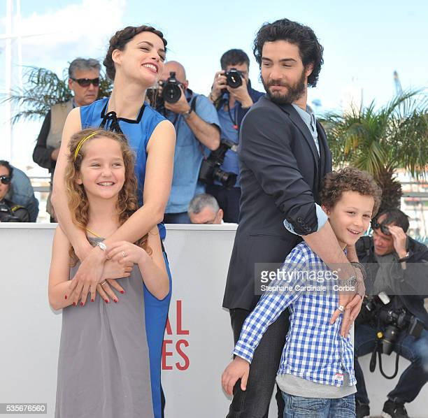 Actress Berenice Bejo Actress Jeanne Jestin Actor Tahar Rahim and actor Elyes Aguis attend Le Passe photo call during the 66th Cannes International...