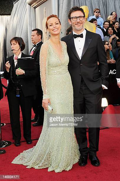 Actress Berenice Bejo and writerdirector Michel Hazanavicius arrive at the 84th Annual Academy Awards held at the Hollywood Highland Center on...