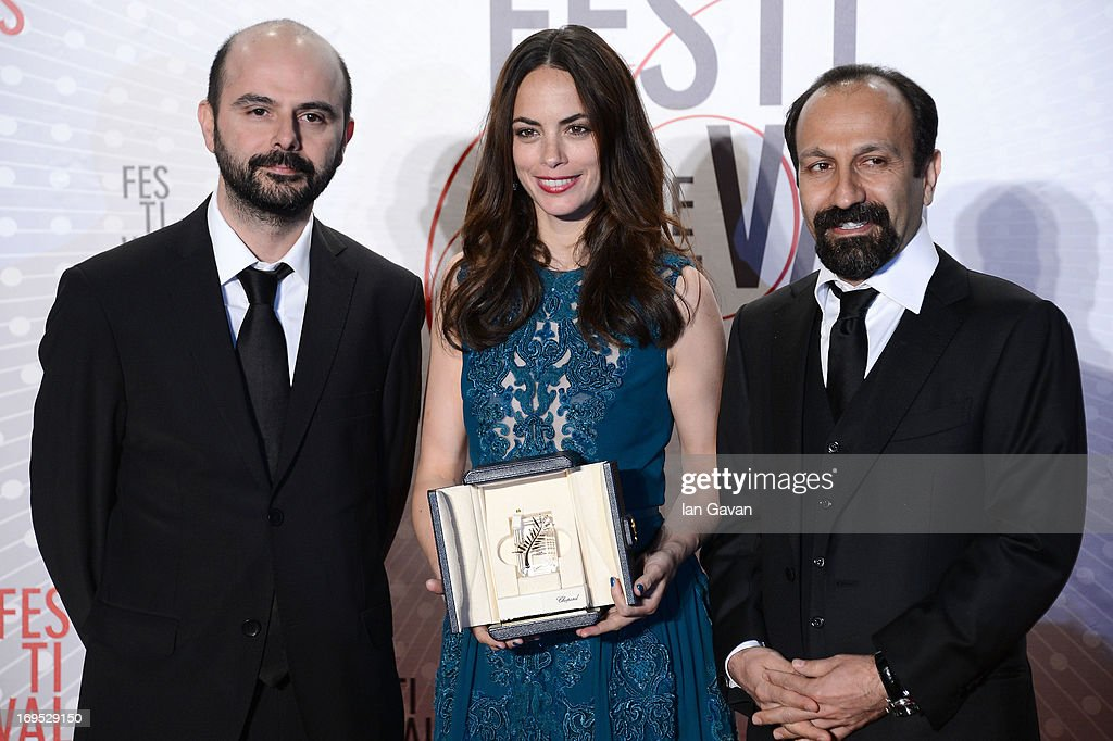Actress Berenice Bejo, awarded with the Prix d'Interpretation Feminine (Best Actress), poses with actor Ali Mosaffa (L) and director Asghar Farhadi at the Palme D'Or Winners dinner during The 66th Annual Cannes Film Festival at Agora on May 26, 2013 in Cannes, France.