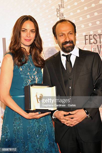 Actress Berenice Bejo awarded with the Prix d'Interpretation Feminine and director Asghar Farhadi attend the 'Palme D'Or Winners dinner' during the...