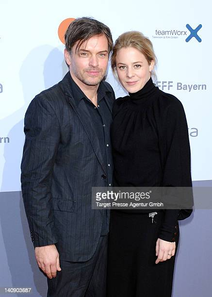 Actress Bernadette Heerwagen and her husband Olaf Puppe attend the premiere of 'Muenchen 72 Das Attentat' at Astor Film Lounge on March 7 2012 in...