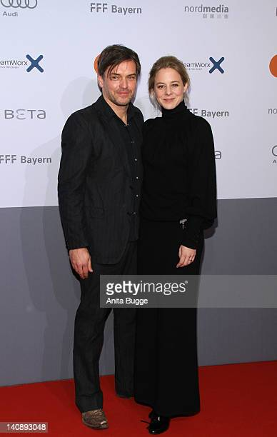 Actress Bernadette Heerwagen and her husband Ole Puppe attend the Muenchen 72 Das Attentat Germany Premiere at Astor Film Lounge on March 7 2012 in...