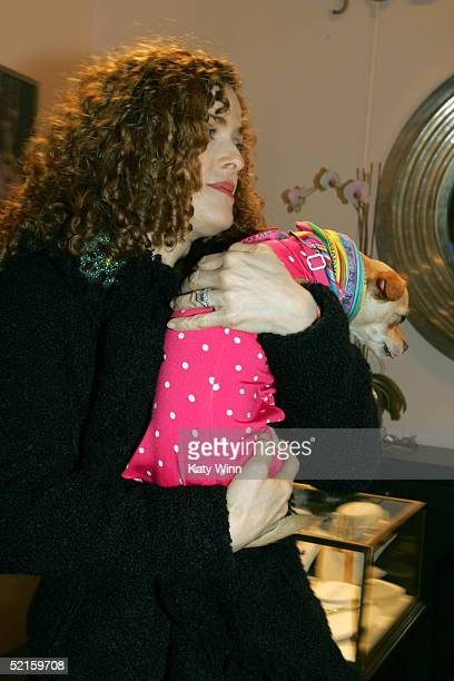 Actress Bernadette Peters is seen carrying Lucy Anne of the Lucy-Anne Diaries in the lobby of the main tent during Olympus Fashion Week Fall 2005 at...