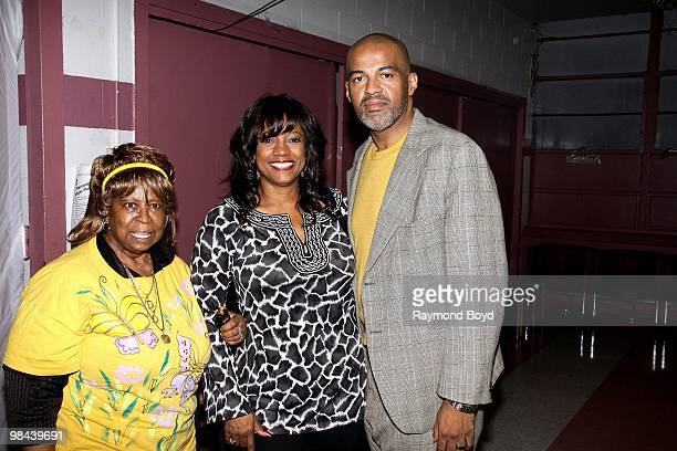 Actress BernNadette Stanis poses for photos with Commissioner Deveria Beverly and Dr Keith L Magee during a Public Housing Tour in Chicago Illinois...