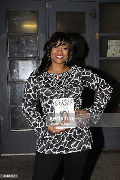 Actress BernNadette Stanis poses for photos with her book Situations 101 during a Public Housing Tour in Chicago Illinois on APRIL 12 2010
