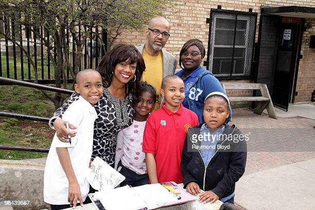 Actress BernNadette Stanis poses for photos with residents of Cabrini Green during a Public Housing Tour in Chicago Illinois on APRIL 12 2010