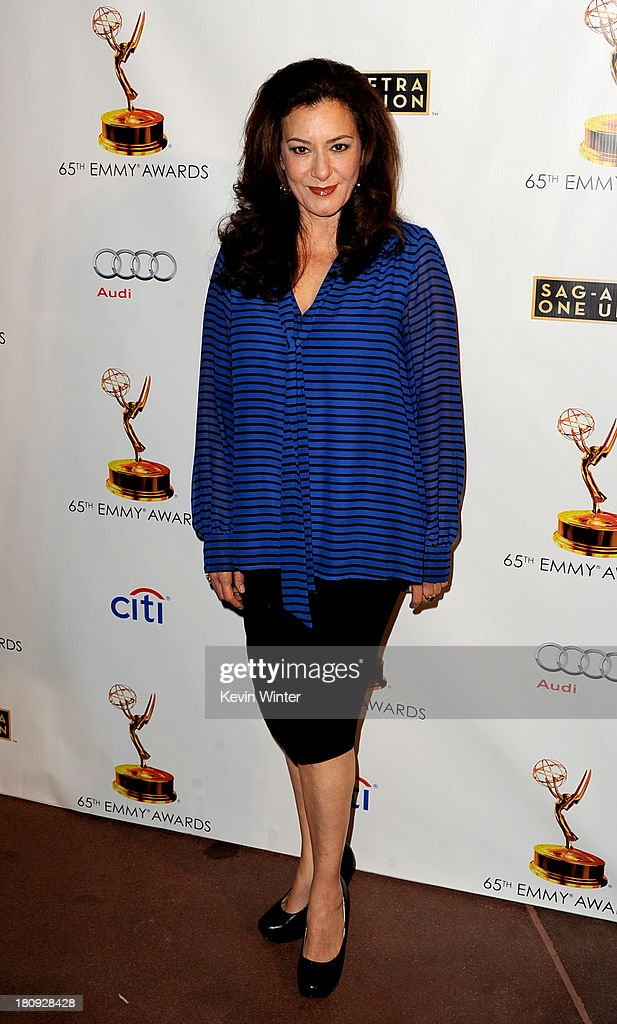 Actress Bertila Damas arrives at The Academy of Television Arts & Sciences and SAG-AFTRA celebration of the 65th Primetime Emmy Award nominees at the Television Academy on September 17, 2013 in No. Hollywood, California.