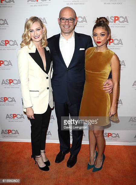 Actress Beth Behrs ASPCA President and CEO Matt Bershadker and actress Sarah Hyland arrive at the ASPCA Benefit at Private Residence on October 20...