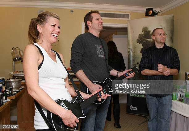 Actress Beth Toussaint and husband actor Jack Coleman are seen playing Guitar Hero III Legends of Rock as Jordan Dodge looks on at The Luxury Lounge...