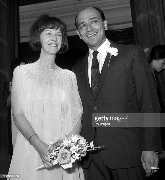 Actress Betsy Blair former wife of dancer Gene Kelly leaves with her hew husband film director Karel Reisz after their wedding at Baddington register...