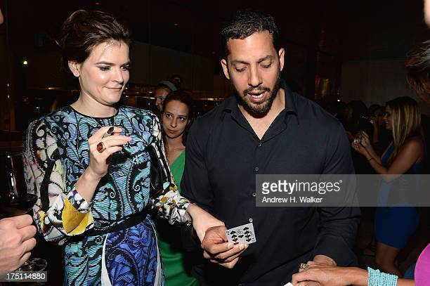Actress Betsy Brandt and magician David Blaine attend the Breaking Bad NY Premiere 2013 after party at Lincoln Ristorante on July 31 2013 in New York...