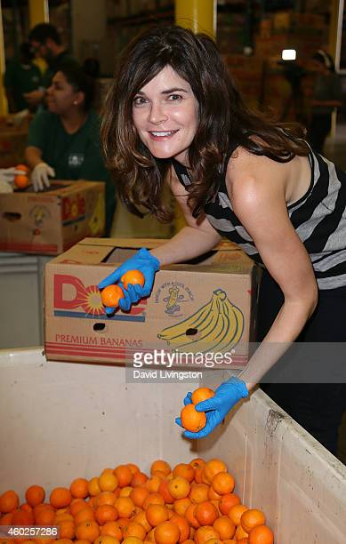 Actress Betsy Brandt attends 'Hope for the Holidays' A Feeding America special celebrity volunteer event at the Los Angeles Regional Foodbank on...