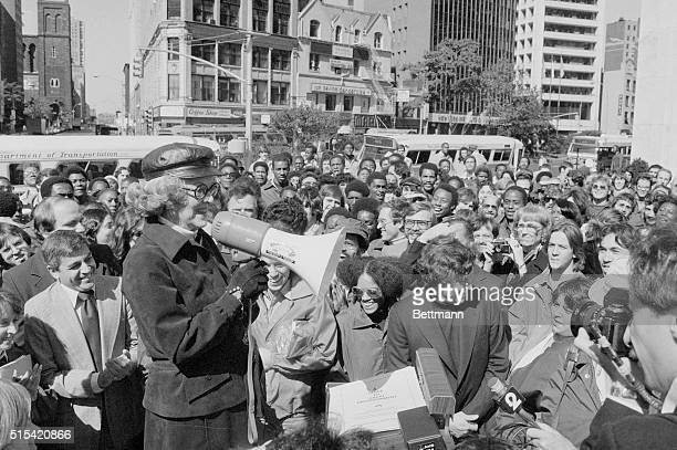 Actress Bette Davis addresses mob of eager Paramount pamphleteers who will advertise her newest movie Death on The Nile as special service moviegoers...