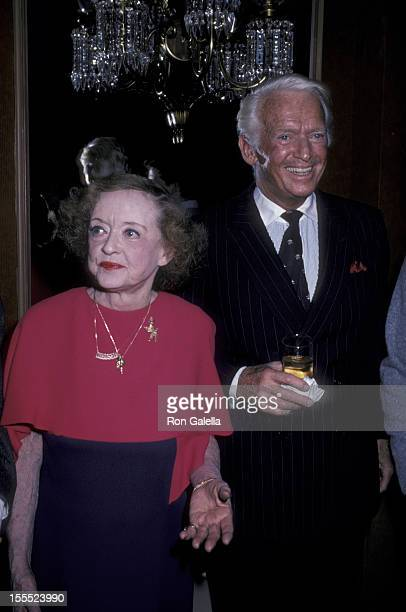 Actress Bette Davis and actor Douglas Fairbanks Jr attend the premiere party for The Mirror Crack'd on December 15 1980 at Le Chantily Restaurant in...