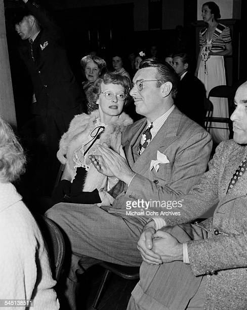 Actress Bette Davis and actor George Brent attend an event in Los Angeles California