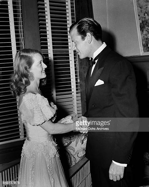 Actress Bette Davis and actor Joel McCrea meet at an event in Los Angeles California