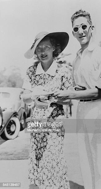 Actress Bette Davis greets a fan as she arrives to an event in Los Angeles California