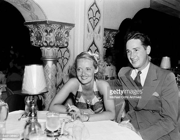 Actress Bette Davis poses with her husband Harmon Oscar Nelson Jr in Los Angeles California