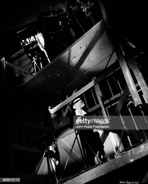 Actress Bette Davis standing high on the rigging of a film set for Warner Bros Studios 1933