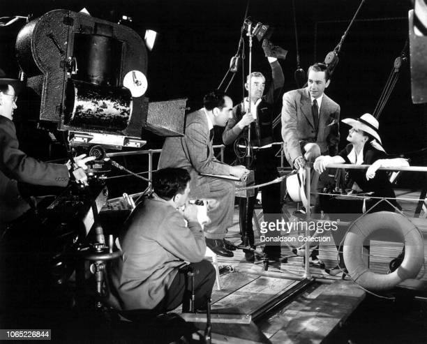 Actress Bette Davis with Irving Rapper and Paul Henreid in a scene from the movie Now Voyager