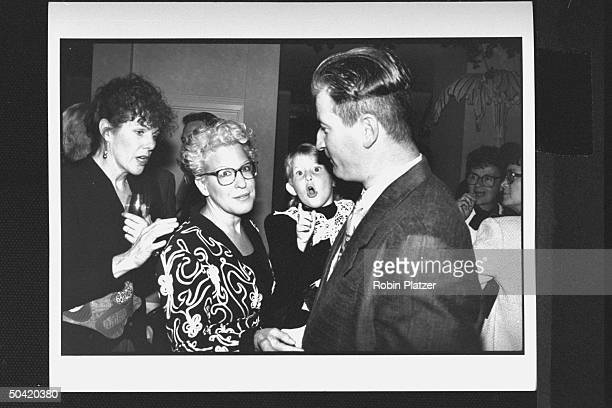 Actress Bette Midler w her husband entertainer Martin Von Haselberg their daughter Sophie as actress Lynn Redgrave greets them at party honoring...